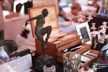 Figurine At The Flea Market