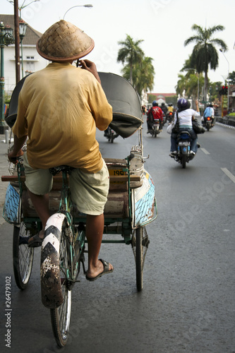 Valokuva  tricycle rickshaw driver yogyakarta