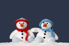 Two Cute Snowmen Sitting In Th...