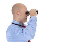 Businessman Looking Through Bi...