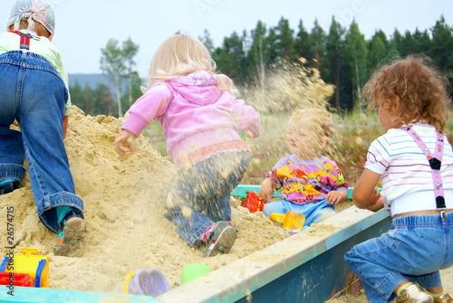 Fotografie, Obraz  Children play to a sandbox