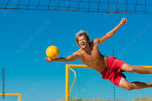 Photo  Beach volleyball - man jumping