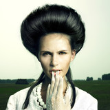 Girl with vintage hairstyle - 26634575