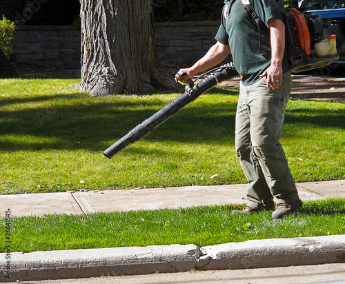 Photo Landscaper with Leaf Blower