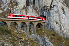 Train On An Old Bridge Going Into A Tunnel