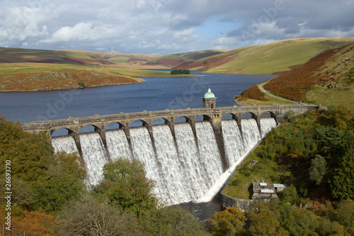 Deurstickers Dam Craig Goch reservoir with water overflowing, Elan Valley, Wales.