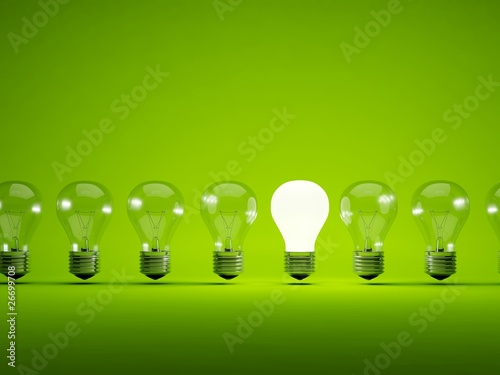 Fotografie, Obraz  Turn on bulb on green background