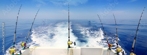 Leinwand Poster boat fishing trolling panoramic rod and reels blue sea