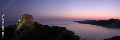 Foto auf Leinwand Aubergine lila Panoramic view at dawn of coastline whit old ruins