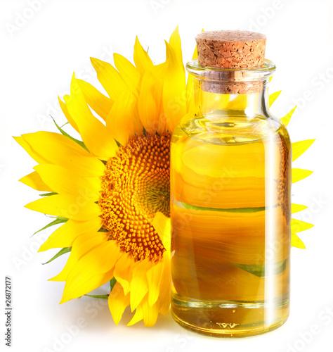 Fototapeta Bottle of sunflower oil with flower. obraz