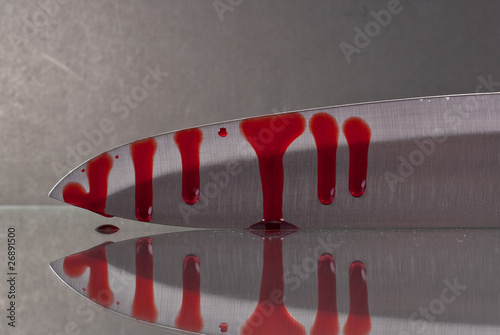 Photo  Blood Oozing Down the Blade of a Knife