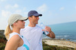 Couple drinking water after exercising