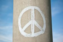 Peace Sign On A Concrete Pillar With Blue Sky