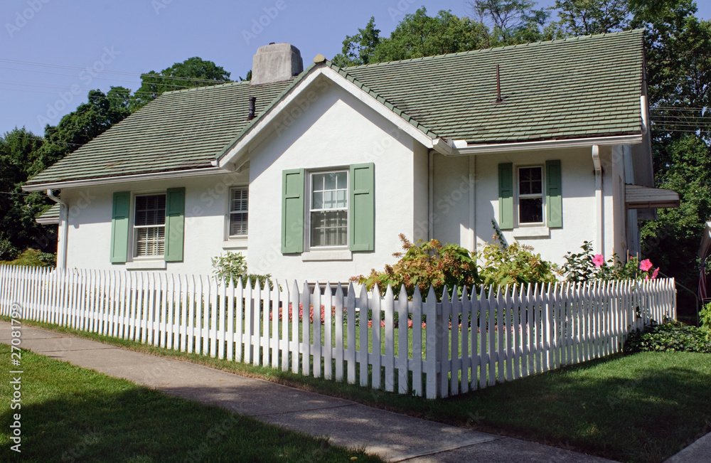 Fototapeta Cottage with Picket Fence