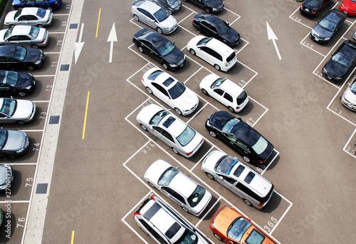 Carta da parati Aerial of a parking house full of cars
