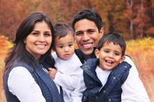 Happy Family Smiling Autumn Po...