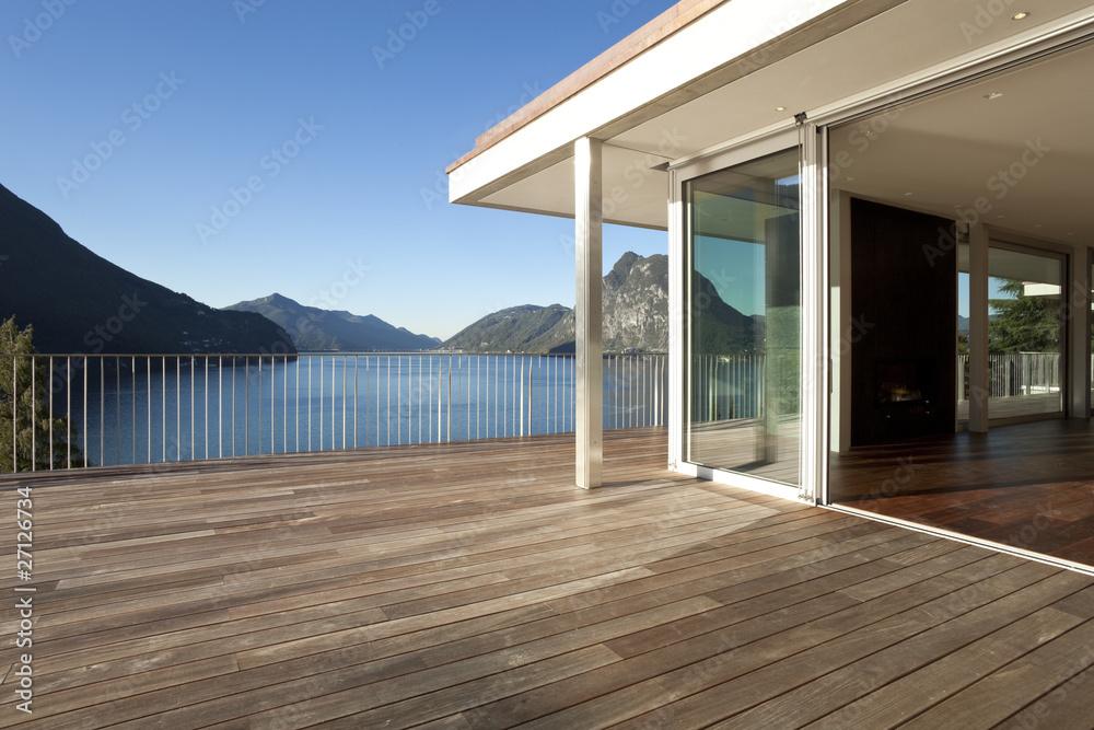 Fototapety, obrazy: Terrazza di casa moderna con vista su lago e montagne.