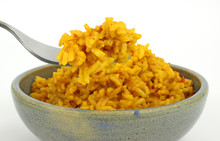 Spicy Seasoned Rice In Bowl With Fork