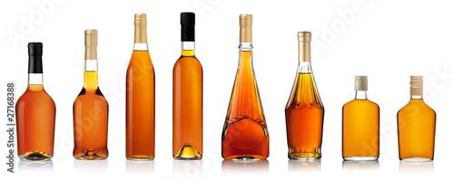 Fotografia Set of brandy bottles isolated on white background