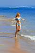 The young beautiful woman on an ocean coast. Indonesia. Bali...
