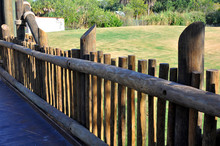 Fence Made From Wooden Logs Wi...