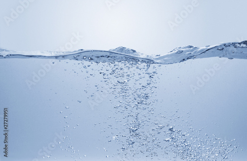 Fotografering  Vague d'eau et bulles