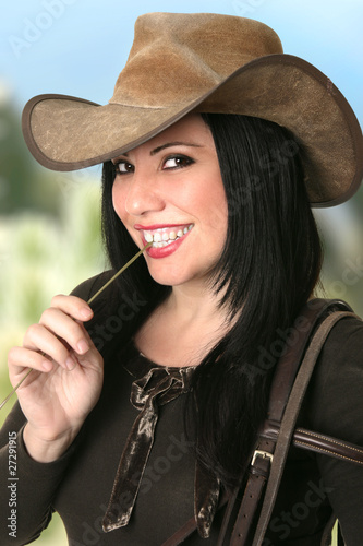 Smiling Cowgirl chewing on lucerne Wallpaper Mural