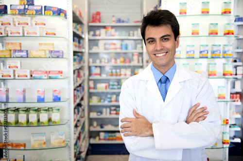 Spoed Foto op Canvas Apotheek portrait of a male pharmacist at pharmacy