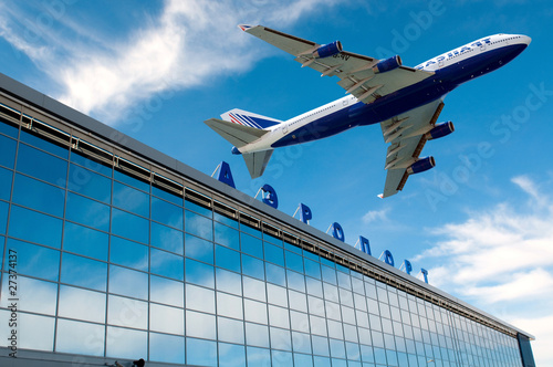 Staande foto Luchthaven The modern russian airport with airplane over it