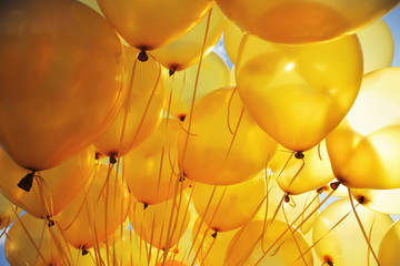 Inflatable yellow helium balloons party background