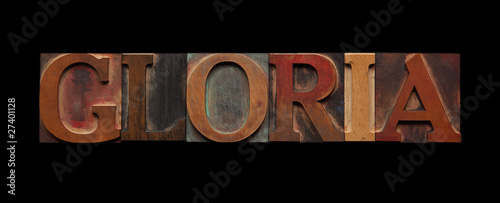 the word gloria in old wood type on black Canvas Print