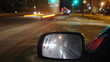 Night city traffic time lapse (focus on the mirror)