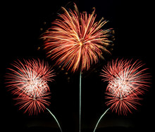 Three Bursts Of Red, White And Gold Fireworks