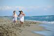 cute little girls running on beach