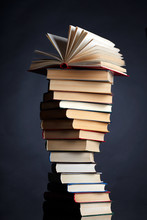 Pile Of Books On A Black Backg...