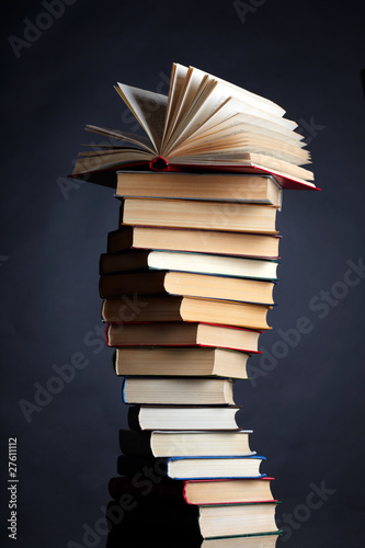 Photo Pile of books on a black background