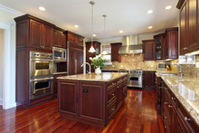 Kitchen With Cherry Wood Cabin...