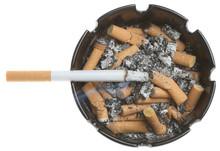 Cigarete In Dirty Ashtray