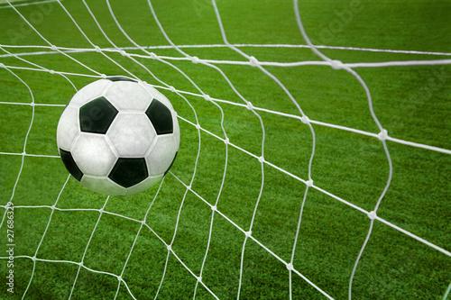 Photo  Goal. a soccer ball in a net.