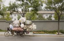Chinese Man On Overloaded Bike