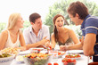canvas print picture - Two young couples eating outdoors