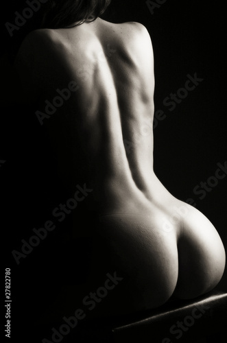 Photo Beautiful ass of young woman over dark background