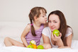 mother and daughter eat apples