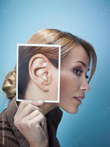Foto  Geschäftsfrau mit großen Ohren