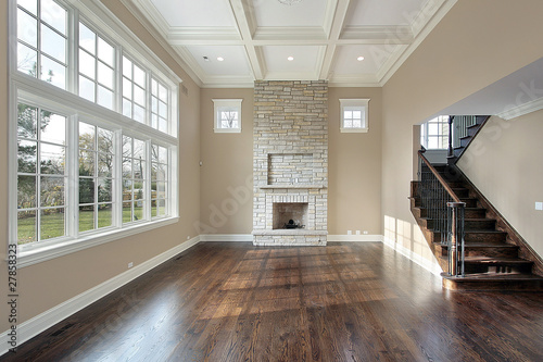 Obraz Family room with two story fireplace - fototapety do salonu