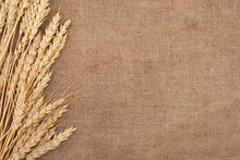 Wheat Ears Border On Burlap Ba...