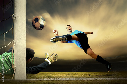 Tuinposter Voetbal Shoot of football player and goalkeeper