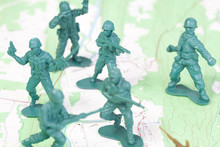 Plastic Army Men Fighting On Topographic Map