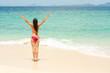 Young lady enjoying sunshine on beach