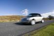 Speeding silver car